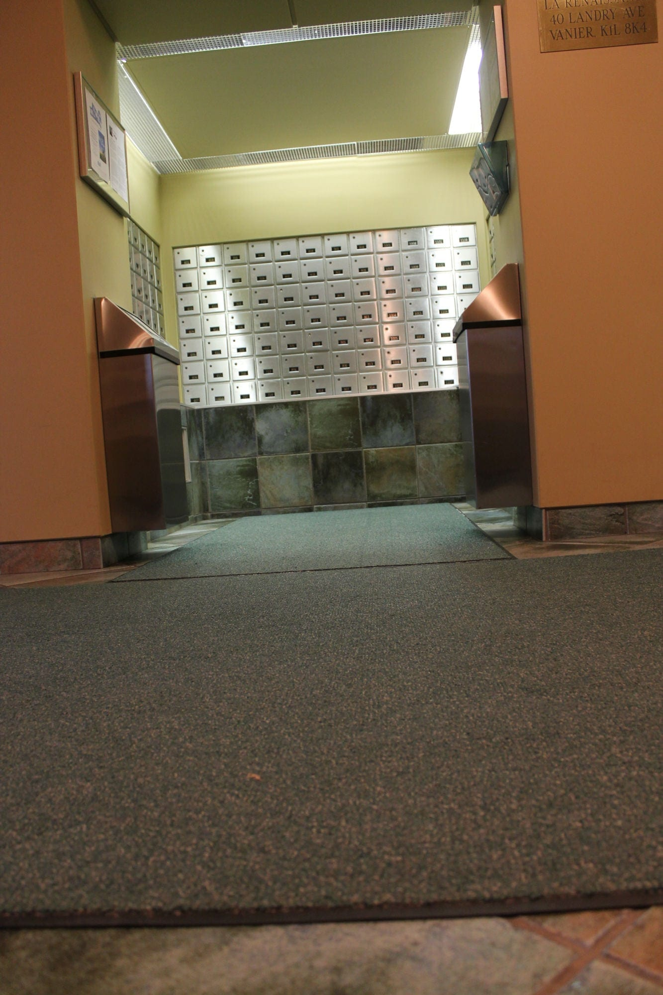 Interior view of entrance matting at La Renaissance Ottawa