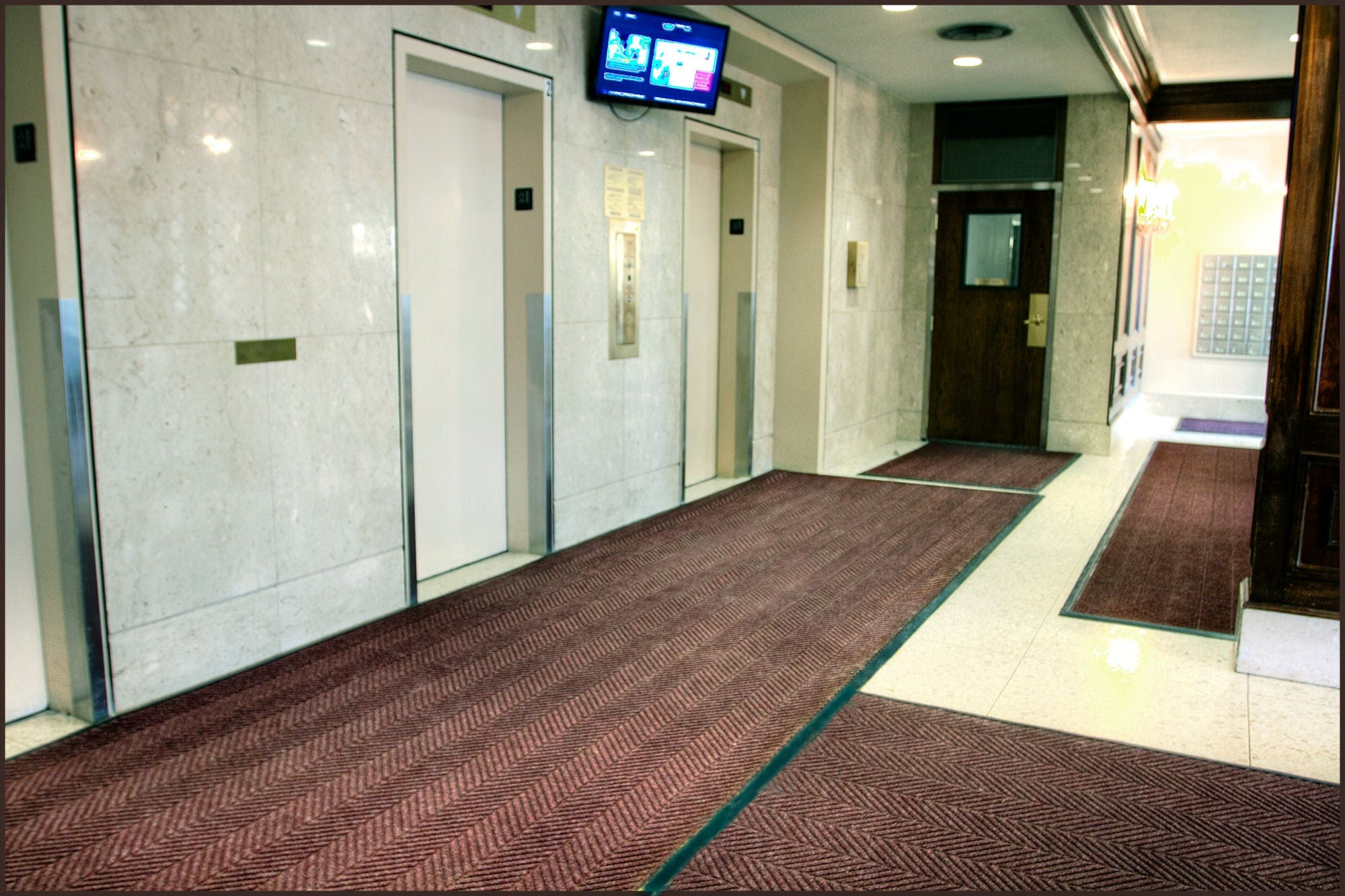 Entryway and elevators at Urbandale's The Watergate